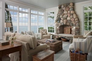 floor-to-ceiling-windows-and-recliner-with-sofa-plus-coffee-table-and-stone-fireplace-for-coastal-living-rooms-cozy-coastal-living-rooms-for-modern-home-decor-coastalliving-nautical-living